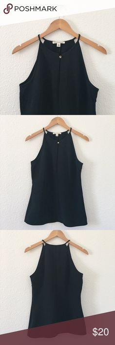 BANANA REPUBLIC Black High-Neck Sleeveless Top This is a high-neck black top from Banana Republic. There is a loop in the front with a gold button, and a zipper on the side. In great condition! Banana Republic Tops Tank Tops