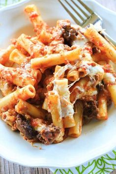This baked ziti is packed with Italian sausage, Romano and mozzarella cheeses, and will become a staple at your family dinners. The perfect baked pasta dish! I have been making this baked ziti recipe Easy Baked Ziti, Baked Ziti With Sausage, Baked Pasta Dishes, Baked Pasta Recipes, Cooking Recipes, Fun Recipes, Fun Cooking, Recipes Dinner, Cooking Ideas
