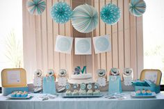 Teal and gray for a boy. Love the accordion globes.
