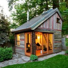 Recycled barn wood backyard house. I want this......