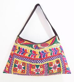 Everybody loves a good vintage bag. This bohemian shoulder bag showcases a colorful piece of vintage fabric from HMONG Hill Tribes in Northern Thailand. #ethniclanna https://www.etsy.com/listing/184575652/bohemien-handbag-hmong-fabric-leather?ref=shop_home_active_5&ga_search_query=Shoulder%2Bbags