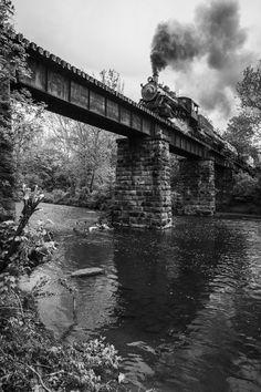 train powering over a bridge