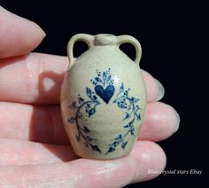 http://www.ebay.co.uk/itm/Jane-graber-blue-heart-Pottery-pitcher-Artisan-miniature-dolls-house-12th-scale-/222282900853?hash=item33c117e575:g:nzgAAOSwxg5X02RH