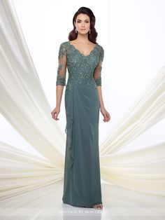 Chiffon slim A-line gown with illusion and lace three-quarter length sleeves, front and back scalloped V-necklines, hand-beaded lace appliqué bodice