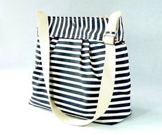 Water-resistant. Comfy. Cute. Perfect for anyone, especially a mom.  @ Esty ($59 + $20 Shipping).  It's from Paris!