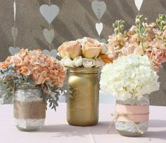 I love the idea of decorating the mason jars differently for pink wedding centerpieces. Gold dipped, lace and burlap, burlap and ribbon