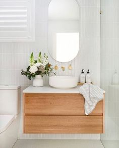 Home Interior Scandinavian Absolutely loving this bathroom vanity design idea! Check out the pretty large wooden mirror with brass faucets accents, and also the wood cabinets with pretty plants for a nice pop of colors White Subway Tile Bathroom, Laundry In Bathroom, Bathroom Renos, Small Bathroom, Bathroom Splashback, Master Bathrooms, Dream Bathrooms, Bathroom Renovations, Bathroom Vanity Designs