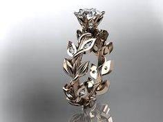 Incorporate nature into your glamour with this leafy wedding ring, complete with a sparkling gem sat on top. #weddingring #weddingideas #weddinginspiration #ruralweddings #devonweddingvenue #2016weddings