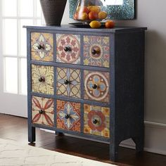 Inspired by the bright patterned tilework of the Mediterranean, Granada brings a zesty global vibe to any space. The mixed-wood chest displays a distressed blue frame and painted faux front featuring nine small drawers but actually contains three large drawers for ample and practical storage.