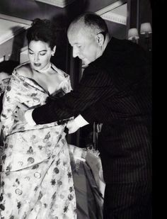 """Christian Dior 1957 – At a costume fitting with Hollywood actress Ava Gardner for her film """"The Little Hut"""". Photo By Rex Features"""