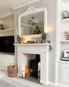 Love the white mirror. Thinking of painting my gold mirror white and hanging above couch.