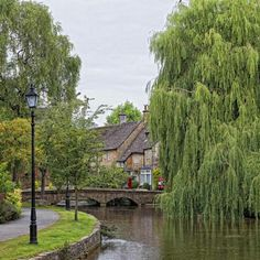 Bourton on the Water, Cotswolds, England. We stayed for one week in the Cotswolds in 2009 and Loved it. England Ireland, England And Scotland, Places To Travel, Places To See, Bourton On The Water, Places In England, English Village, British Countryside, Beautiful Places