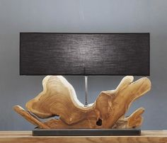 Naga:Visually stunning recycled teak lamp base with amazing grain and natural knots of the wood.This unique masterpiece would stand out in a crowd, it's truly beautiful style and rustic charm gives an edge to this lampand would be an eye catcher on any sideboard, table or dresser.