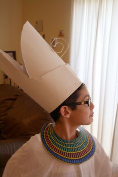 Egyptian costume:  long white t-shirt, cardboard collar downloaded from the web + colored, posterboard crown