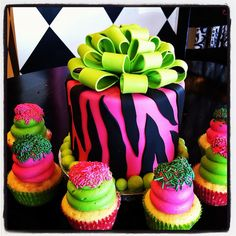 Pink and green cupcakes with zebra smash cake