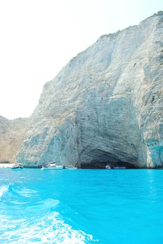 Navagio Beach, on the coast of Zakynthos, Greece.  I want to find out if the water is this blue.