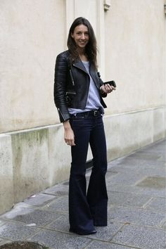 Geraldine Saglio: Flared dark jeans with black leather jacket.