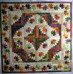 Barb had me quilt this leafy wallhanging for her.  She says she has a spot in her house where she hangs a quilt that she changes wit...