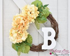 This wreath is a lovely addition to your Spring and Summer decor! Three large full faux hydrangeas stand out against a natural grapevine background and accented by a variety of greenery.