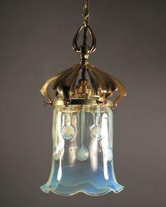 Really lovely glass vaseline pendant light.