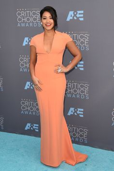 Actress Gina Rodriguez wore an elegantly bright, cap-sleeved SAFiYAA gown and let her stunning ring steal the spotlight on the Critics' Choice Award red carpet.