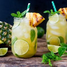 Pineapple Ginger Mojitos with Spiced Rum - a sweet and spicy twist on the classic mojito cocktail. Served with a wedge of caramelized pineapple. Ginger Mojito, Pineapple Mojito, Spicy Drinks, Yummy Drinks, Rum Recipes, Cocktail Recipes, Dessert Recipes, Lemon Soup, Longest Recipe