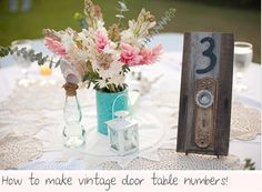 Old fashioned door knobs for table numbers!