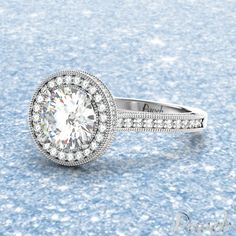 perfect just like you http://paveb.com/engagement-rings/brilliant-cut-cathedral-millgrain-halo-diamond-engagement-ring.html#970=127