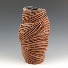 Carved sculptural ceramic pottery vase in Rich Red. Handmade by Judi Tavill Ceramics