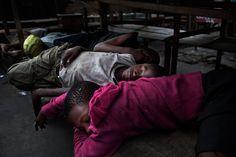 Street_children_sleeping_at_the_market