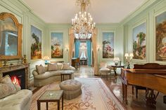 Listing of the Day: A Neo-Georgian Townhouse on the Upper East Side Designed in the style of Louis XIV, the sitting room on the parlor level features 10 French Rococo canvases and a hand-carved marble fireplace. The entire floor has 12-foot-tall ceilings. EVAN JOSEPH 1/6 LOCATION: New York PRICE: $25 million Set behind a wrought-iron gate on Manhattan's Upper East Side, this neo-Georgian-style townhouse spans five floors. The 15-room home includes a marble foyer, five bedrooms, eight bath