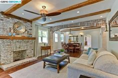 Gorgeous Living room / Dining room with brick.