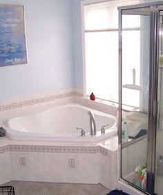 Corner Bath Tub, Custom Skirt Made Of Tile, Tile Backsplash, Glass Shower.