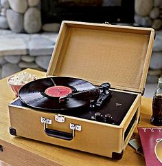 My fist record player was a box like this.....white outside and red inside got a beetles album to go with it, wish I still had the album!!