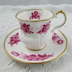Tea cup and saucer with pink flowers. Cup and saucer have gold trimming. Excellent condition (see photos). Markings read: Elizabethan Fine Bone China England Please bear in mind that these are vintage items and there may be small imperfections from age or flaws from production. I try