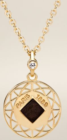 Eiffel Tower necklace with real piece of the Eiffel Tower!  Beautiful vermeil (18K yellow gold over sterling silver) pendant with white sapphire in bail.  Inscribed Paris 1889, the year the Eiffel Tower opened.  Limited quantities.  Rare.  Precious.  Available now at https://korbella.com