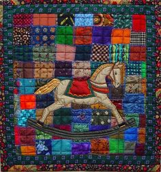Colorful child's rocking horse quilt.