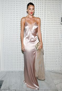 Shimmering: The 28-year-old actress looked good in a shiny pink silk nightie-inspired numb...