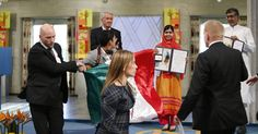 A man brandishing a Mexican flag stained with blood-red paint disrupted Malala Yousafzai's Nobel Peace Prize acceptance ceremony on Wednesday.