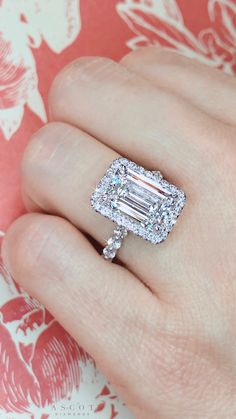 Custom design ring by Ascot Diamonds, featuring an emerald cut diamond center expertly set in a delicate halo of round brilliant diamonds. A modern classic. Dream Engagement Rings, Halo Diamond Engagement Ring, Diamond Wedding Rings, Bridal Rings, Wedding Bands, Radiant Engagement Rings, Wedding Jewelry, Emerald Cut Diamonds, Diamond Cuts