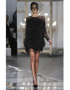 Jason Wu - a master. Feathers all over with just a few inches of sheer lace to accent. This is one of those outfits where you have to be super thin to pull it off.