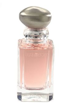 Laura Mercier Eau de Lune is a true modern classic offering a romantic floral scent using a signature blend of white flower petals blended with mandarin and subtle hints of violet and ylang-ylang. Top notes are composed of plumeria rose and other fresh scents. Base notes consist of orris amber and musk to complete a long-lasting sensual fragrance. 1.7 oz (50 ml)