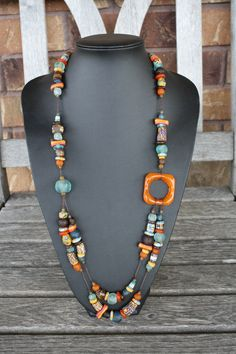 one of the coolest recycled glass necklace designs I've seen. from Big Village in Ontario