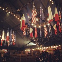 A crown of flags hanging over the catwalk at the #Chanel Paris-Dallas show #chaneldallas
