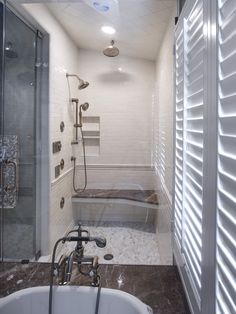 This shower includes multiple body sprays, a rain shower head and a steam machine. From Dreamy Tubs and Showers