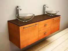 "If you were wondering which is the standard height of a regular bathroom vanity cabinet, that would be 32"", although the range can be anywhere from 30"" to 36"" or so. Nowadays, the modern units are taller, and they are named comfort height vanities. Another thing to note here is that vanities can end up coming with a multitude of height options. You need to think about the vessel sink height, comfort height, and then you also have the standard height. Most of the time you will see that there…"