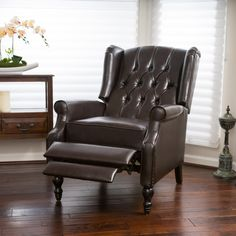 The Walter bonded leather recliner club chair will make a statement in any room of your home. The shape and height of the back command attention while the armrests and cushioned seat allow for comfort.