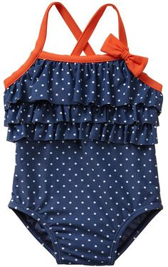 New Baby Gift:  Girls Ruffle Dot One Piece Swimsuit (Blue Chill) at Baby Gap.  For twins, pick up the matching one-piece in new dark orange too.