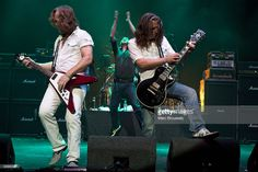 Luke Morley, Danny Bowes and Ben Matthews of the band Thunder perform on stage at Hammersmith Apollo on July 11, 2009 in London, England.