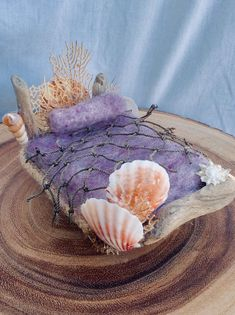 A miniature mermaid fairy bed, it is made of wood, driftwood, shells and coral sea fan. There is a fishnet coverlet and hemp rope edging. Mini Fairy Garden, Fairy Garden Houses, Fairies Garden, Gnome Garden, Garden Pots, Mermaid Toys, Mermaid Fairy, Sea Crafts, Fairy Crafts